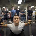 Man squatting weights