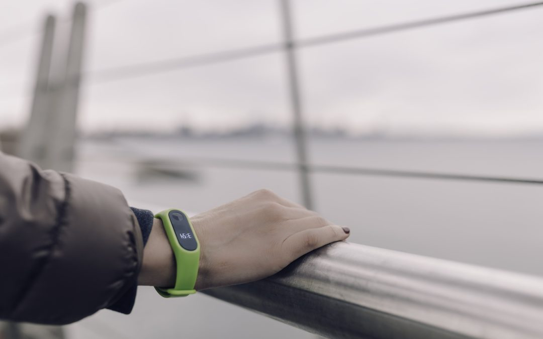 lady holding railing wearing a fitbit