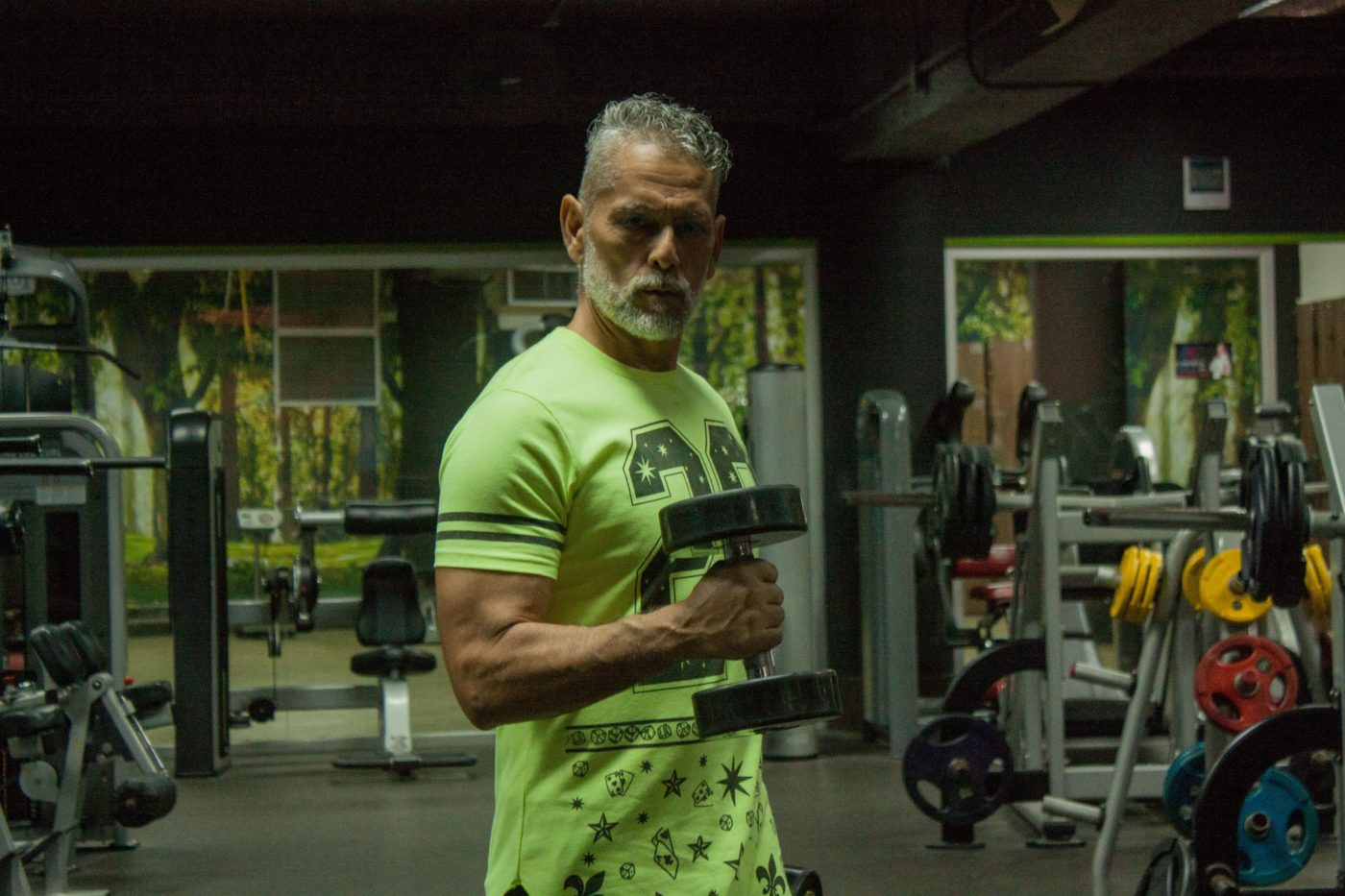 Older man lifting a dumbbell
