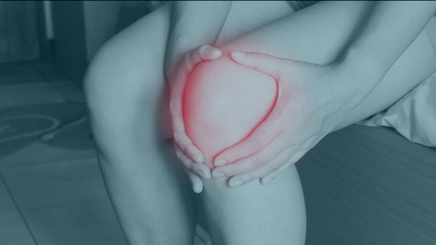 girl holding sore knee