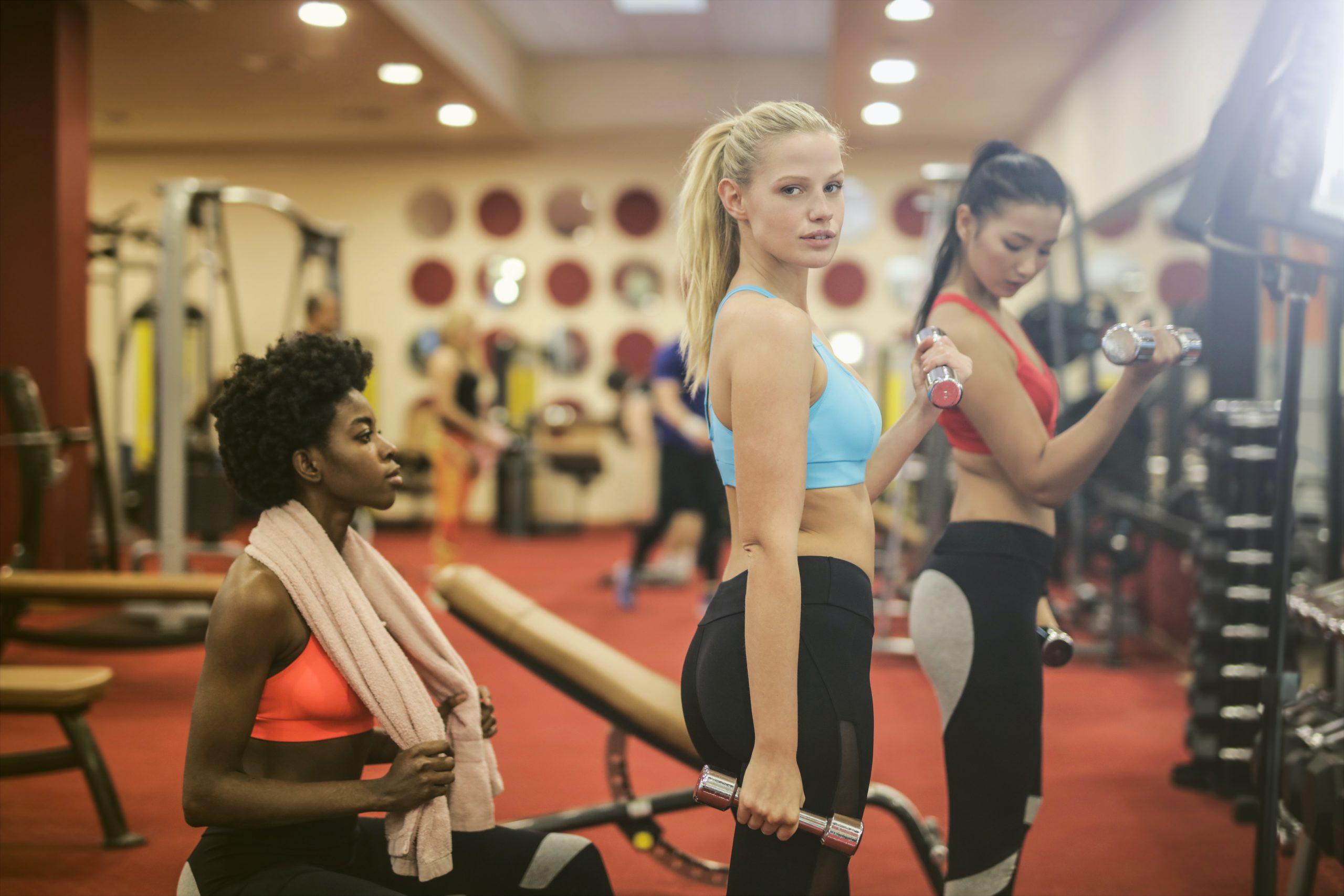 girls lifting weights looking at the camera